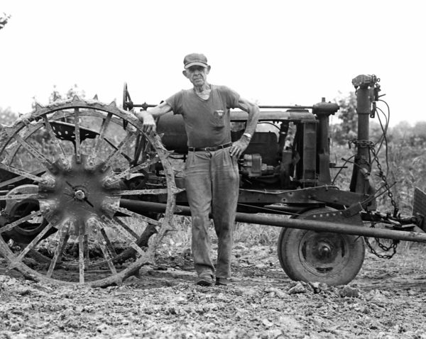 Bruce Crippen, Erwin Cutter John Deere Tractor, 1982. Black and white photograph, 11 x 14 inches. Courtesy of the artist