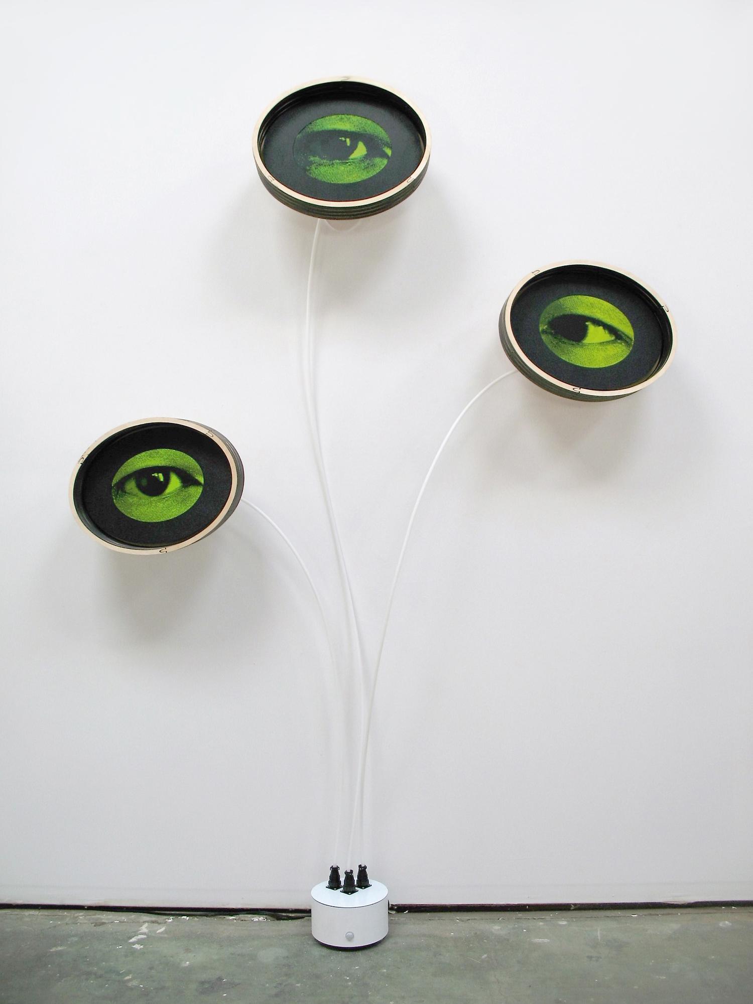 Alan Rath, Eyeris VIII, 2016. Sculpture: Birch plywood, acrylic, polyethylene, aluminum, custom electronics, LCDs, 87 x 60 x 10 inches. Courtesy of the artist and Carl Solway Gallery